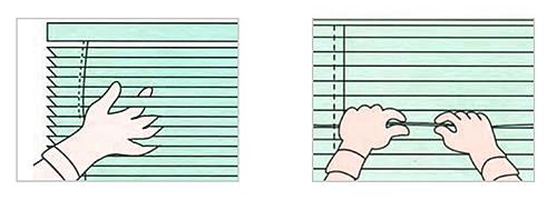 ブラインドスラットを軍手をはめた指で挟み、掃除している画像